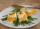 Stuffed scallops on green asparagus