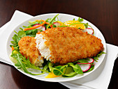 Breaded Alaska pollock on salad