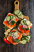 Salmon rolls with cream cheese, cucumber and dill