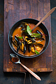 Mussel soup with redvein dock leaves