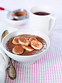 Chia pudding with banana slices, almond butter and cocoa powder