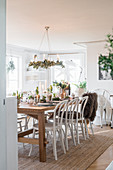 Festively set table in dining room in natural shades