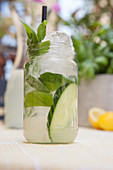 Lemonade with cucumber and basil outdoors