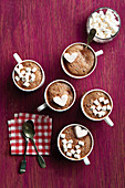 A selection of different hot chocolate drinks with marshmallows