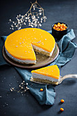 Quark cream cake with sea buckthorn, sliced (vegan)