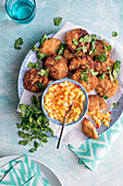 Spiced cauliflower fritters with chilli and pineapple salsa and fresh coriander