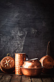 Different kind of vintage copper cookware over dark background