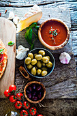 Fresh italian pizza ingredients on wood, cheese, salami and tomatoes