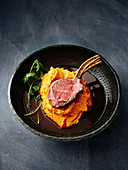 Tea-smoked lamb with coconut sweet potato mash