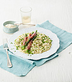 Green asparagus risotto with chives and asparagus and ham rolls