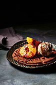 Brownie waffles with caramelized mandarins and chocolate ice cream