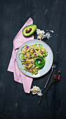 Linguine with avocado, garlic, feta cheese and pesto