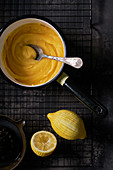 Lemon Curd in Saucepan, dark background