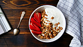 Muesli with crunchy oatmeal, yogurt and strawberries