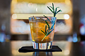 A cocktail with rosemary