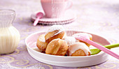 Deep-fried, sweet yeast dough balls with vanilla sauce and icing sugar