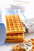 Cheese and spelt waffles with a sour cream and bacon dip