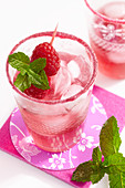 A raspberry and prosecco cocktail with mint