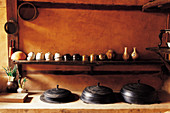 A traditional Korea kitchen with crockery and pots (Asia)