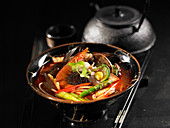 Jjamppong (spicy noodle soup, China) with seafood