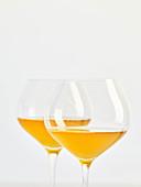 Two glasses of natural wine (orange wine)