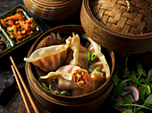 Asian dumplings in a bamboo basket