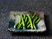 Green asparagus and green beans on a plate