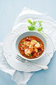 Fish stew with diced bacon