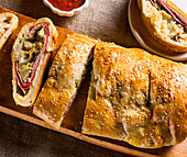 Stromboli stuffed with sausage and vegetables (top view)