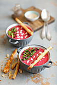 Young beetroot cream soup with puff pastry sticks