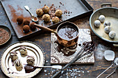 Handmade truffle pralines with chocolate sauce
