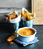 Curry dip with potato wedges
