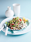 Couscous salad with lemon, cucumber, tomato, yogurt, onion and herbs