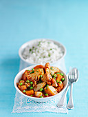 Cauliflower curry with peas, carrots, potatoes and rice (India)