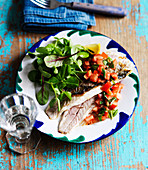 Fish with Italian tomato and olive sauce