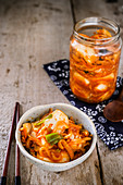 Kimchi in a jar and in a bowl
