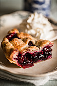 A piece of blueberry pie with cream