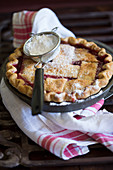 Cherry pie with a pastry lattice and powdered sugar