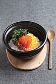Korean rice with roe in a stone pot