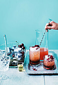 Prosecco punch with vanilla, blueberries and cherries