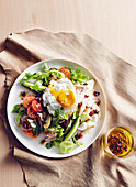 Salade nicoise with potatoes, heirloom tomatoes and a fried egg