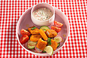 Fish fingers with cucumber salad and yogurt mayo dressing