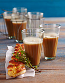 Hot drinks with a puff pastry plait and thyme