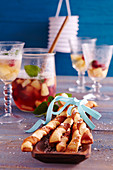 Pineapple and raspberry punch with spicy yeast dough and puff pasty Parmesan sticks