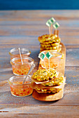 Mini prawn and sweetcorn fritters with chilli sauce in jars