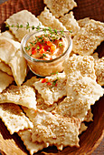 A pepper dip and crackers