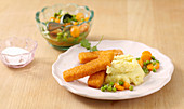 Fish fingers and mashed potatoes with a pea and carrot medley