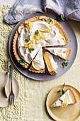 Lemon tart topped with whipped cream