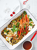 Honey-glazed carrots with feta cheese on a spelt and lentil medley