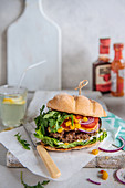 Cheese burger with salad and sweetcorn relish